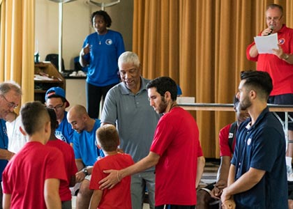 76ers Hall of Famer Julius Erving congratulates camper at the Awards Ceremony.