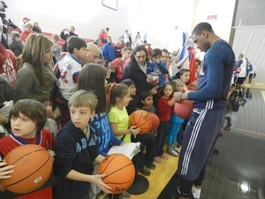 Thad signing autographs