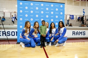 SIXERS CAMPER POSING WITH THE SIXERS DANCERS