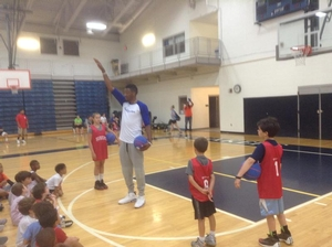 Campers working on their shooting form with Robert Covington.