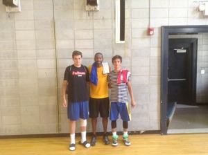 Mustafa and Efe with Former Sixer Doug Overton.
