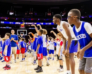 Sixers campers on court at the center