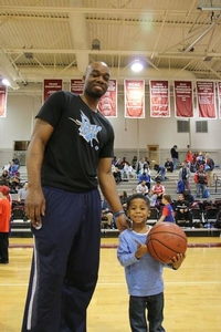 Carl Landry poses for picture with little sixer camper.