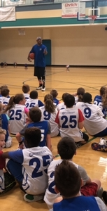 Cory the dribbler visits Sixers day camps.