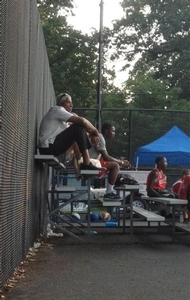Dr. J watching his boys play at camp