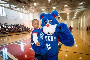 Franklin poses with a future Sixers Camper.