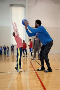 Sixers Camper blocking the ball from Joel Embiid.