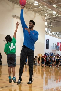 Joel Embiid plays one on one with Sixers camper.