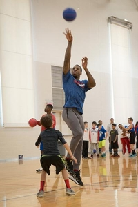 Thomas Robinson plays one on one with a Sixers camper.