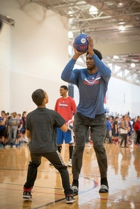 Joel Embiid shows proper ball fake against Sixers camper.