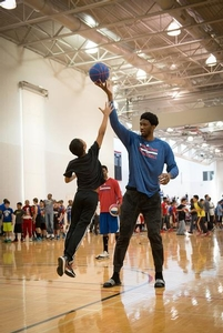 Sixers Camper tries to steal the ball from Joel Embiid.