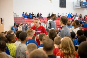 Coach Brett Brown gives motivational speech to campers.