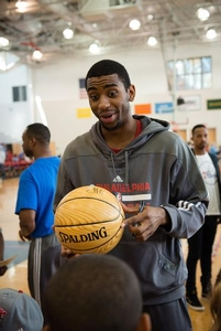Hollis Thompson getting ready to sign a camper's basketball.