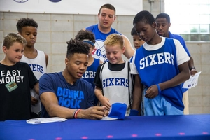 Fultz signs autographs for campers and interns