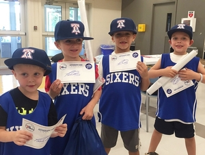Day campers receive 76ers hats.