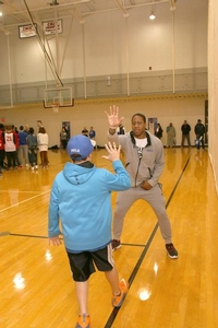 Isaiah Canaan high fives camper.