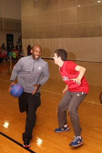 Sixers camper working on his defensive skills with Sixers Assistant coach, Lloyd Pierce.