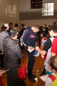Nik Stauskas taking the time to sign autographs for the campers to take home.