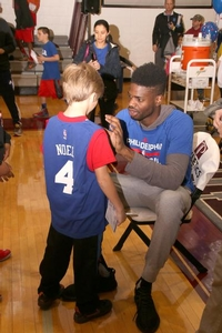 Nerlens Noel autographs a camper who is wearing his #4 jersey!