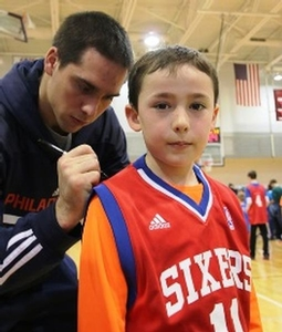 TJ McConnell signs a camper who is wearing his number!