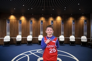 CAMPER IN HIS SIXERS JERSEY