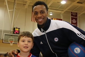 Ish Smith taking a photo with camper.