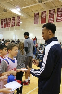 Camper getting that Ish Smith autograph.