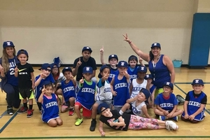 Little Sixers posing with their new 76ers hats.