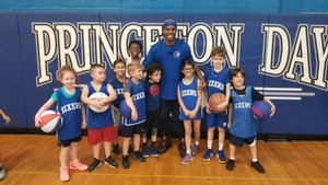 Cory the dribbler with campers from Princeton.