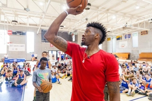 Robert Covington teaches overnight campers shooting drills
