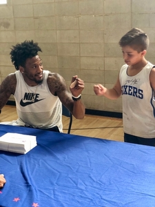 Overnight camper making friends with 76er, Robert Covington