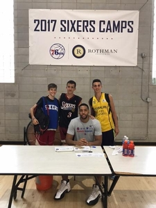 Jahlil Okafor with campers from Spain