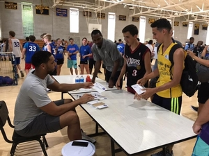 Jahlil Okafor signs autographs for campers