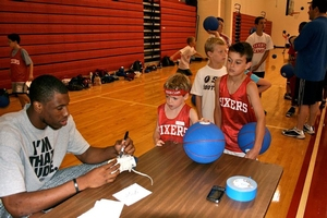 Thaddeus Young signs for campers at WCE