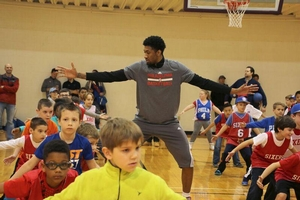 Campers working on their defensive stance with 76er, Christian Wood.
