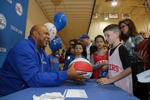 Autographs with former 76er pro, World B. Free!